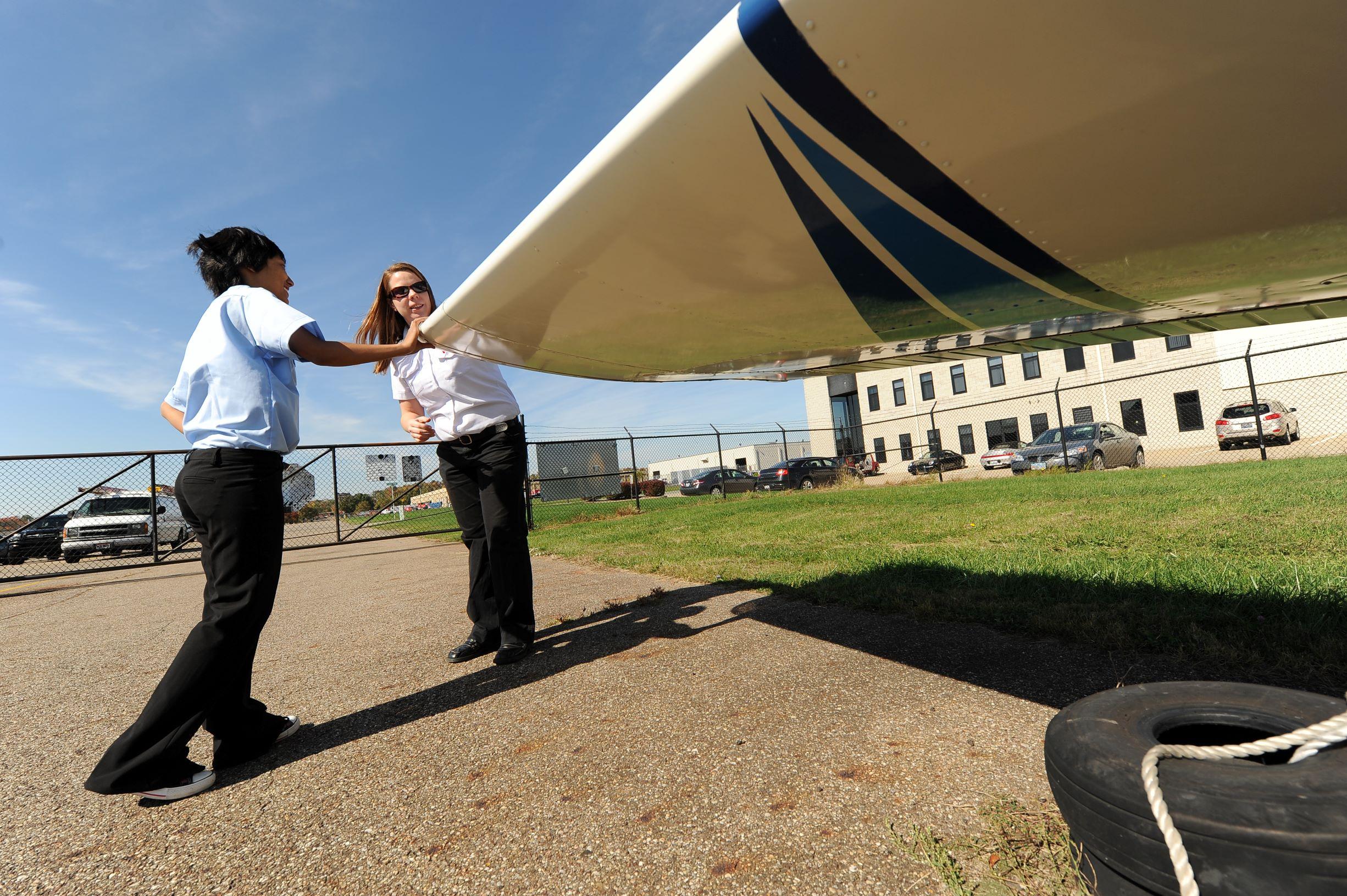 Pilots looking at wing